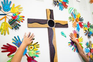 St Therese Mascot Catholic Primary School Family and Faith Hands on paper handprints around cross